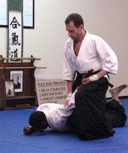 Sensei Michael performs an ikkyo pin during his nidan examination.